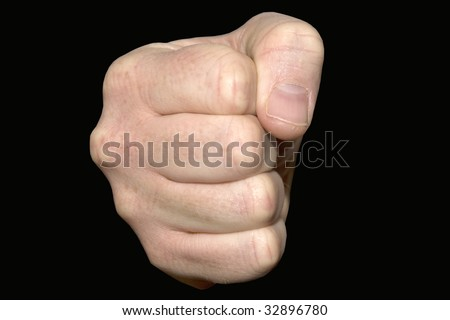 Close up of a clenched fist on a black background - stock photo