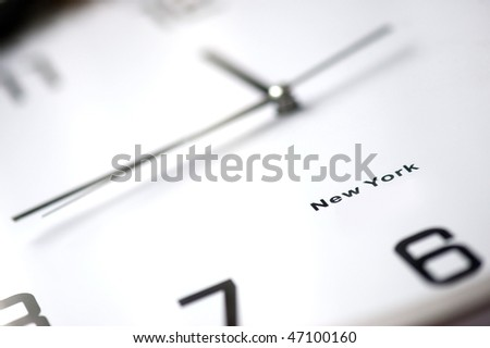 Close up of a clock, almost lunchtime (swallow DOF) - stock photo