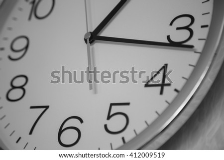 close up of a clock in black and white