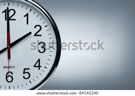 Close up of a clock isolated ob blue background with copy space - stock photo
