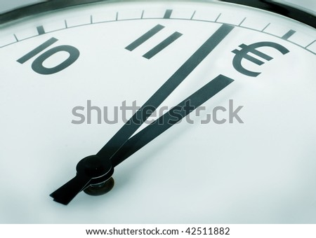 close-up of a clock where number twelve is the euro currency symbol - stock photo