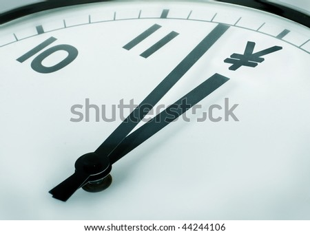 close-up of a clock where the twelve o'clock sign dollar symbol - stock photo
