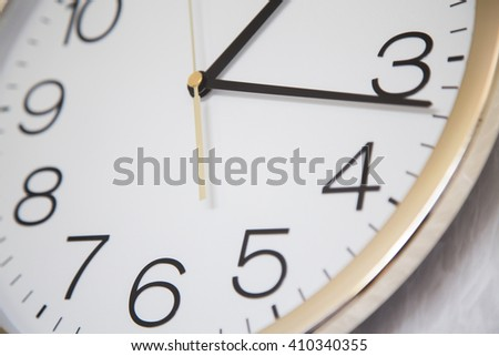 close up of a clock with a gold edge