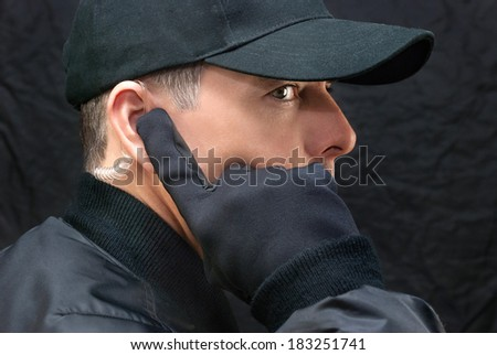 Close-up of a close protection guard scanning for threats. - stock photo