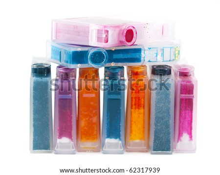 close-up of a CMYK ink cartridges for a color printer - stock photo