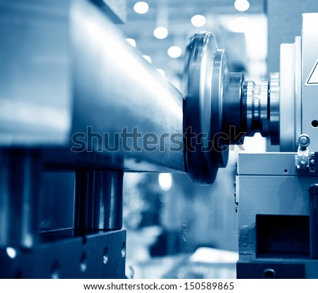 Close-up of a CNC machine at work. - stock photo