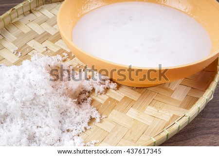 close up of a coconut milk  and grounded coconut flakes. Selective focus - stock photo