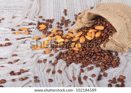 Close up of a Coffee beans and almonds in bag - stock photo