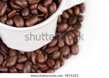 Close-up of a coffee cup filled with coffee beans