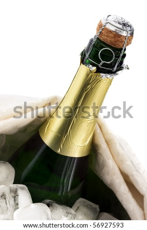 Close-up of a cold bottle of champagne on ice with white background - stock photo