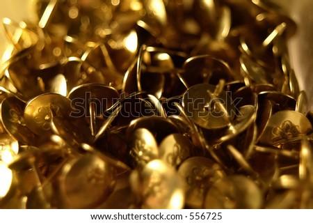 Close up of a collection of drawing pins / thumb tacks. - stock photo