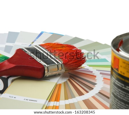 Close-up of a color palette and a brush ,isolated on white background - stock photo