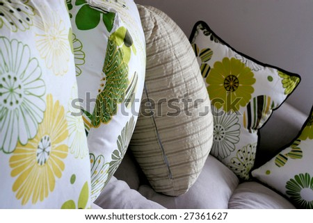 Close-up of a colorful cushions on a sofa - home interiors - stock photo