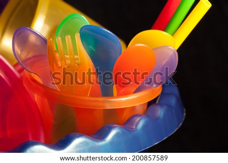 Close up of a colorful set of baby cups bowls Forks and Spoons