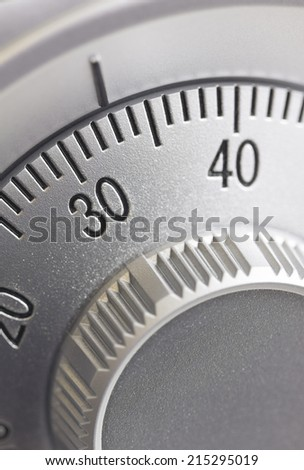 Close-up of a combination dial on a safe.