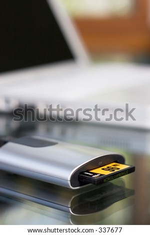 Close-up of a compact card reader - stock photo