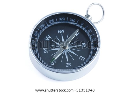 close up of a compass with slight blue filter effect - stock photo
