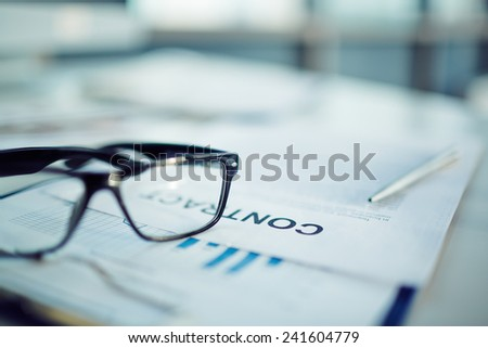 Close-up of a contract and glasses - stock photo
