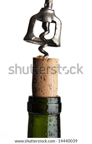Close up of a corkscrew uncorking a bottle of red wine - stock photo