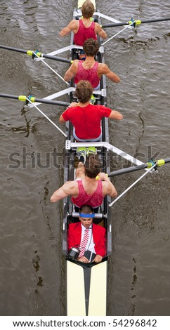 Close up of a coxed four rowing team, seen from above - stock photo
