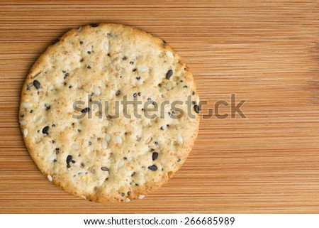 Close up of a cracker against a bamboo background with copy space. - stock photo