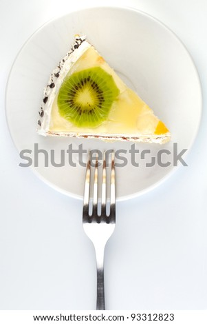 Close-up of a creamy cake with fork - stock photo