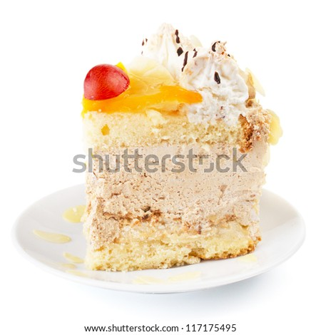 Close-up of a creamy cake with fruits and almonds - stock photo