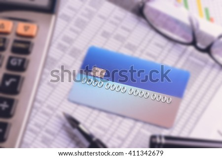 Close up of a credit cards with credit card statements,account,pen, calculator and glasses - stock photo
