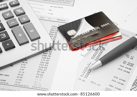 Close up of a credit cards with credit card statements,pen and calculator - stock photo