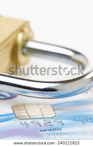 Close up of a credit or debit card with padlock. Card security concept. Card account number changed for security purposes.