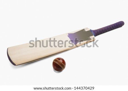 Close-up of a cricket ball with a bat
