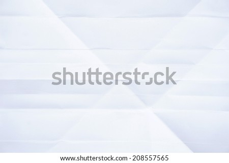 close up of a crumpled unfolded piece of white paper - stock photo