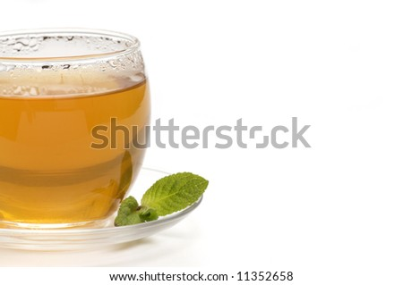 close-up of a cup of tea with a mint leaf