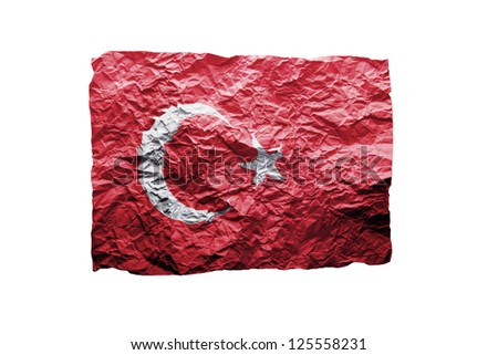 Close up of a curled paper on white background, print of the flag of Turkey - stock photo