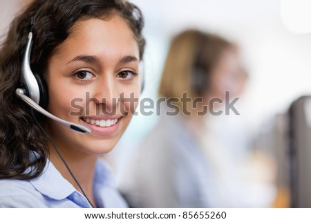 Close up of a customer assistant wearing a headset - stock photo
