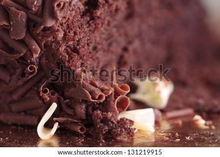 Close-up of a cut chocolate cake - stock photo