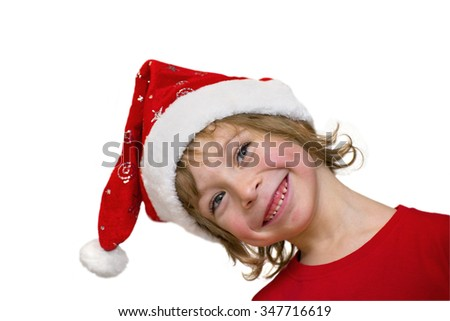 Close-up of a cute little boy with Santa hat, smiling, head sideways, blue eyes, blonde hair, isolated on white background