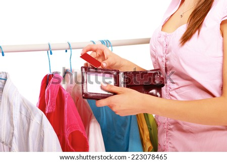 Close-up of a cute woman paying with her credit card in a shop.