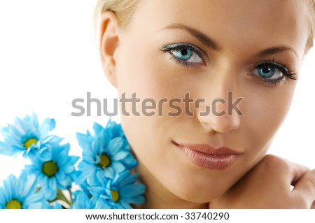 close up of a cute woman with big eyes and blue daisy - stock photo