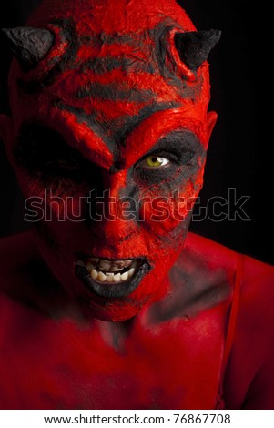 Close up of a devil. Low key lighting. - stock photo