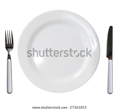 Close up of a diner plate with fork and knife - stock photo