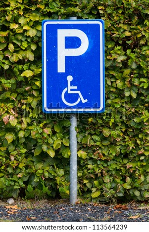 Close-up of a dirty parking sign for disable people - stock photo