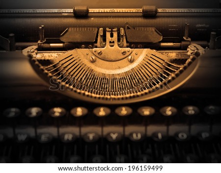 Close up of a dirty vintage typewriter, warm filter - stock photo