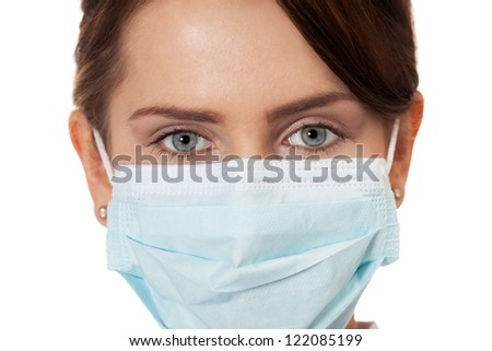 Close up of a doctor in surgical mask - stock photo