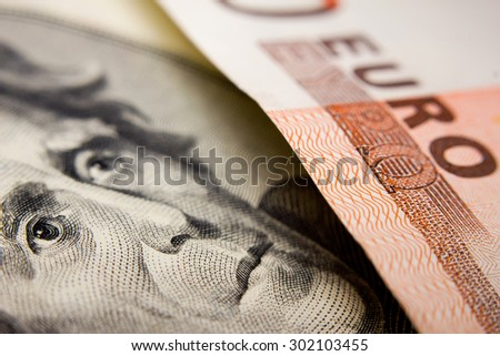 Close-up of a 20-dollar note (figuring president Jackson) and a 50 euro banknote - stock photo