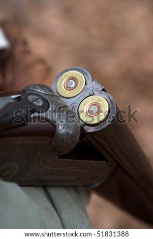 Close-up of a double-barrell shotgun after being loaded. - stock photo