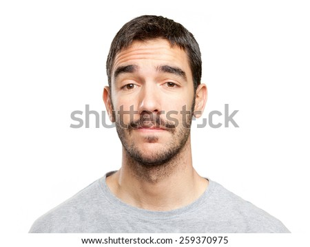 Close up of a doubtful young man - stock photo