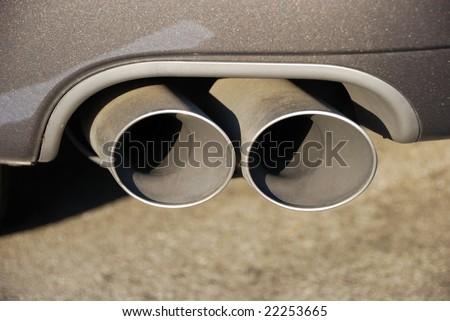 close-up of a dual muffler - stock photo