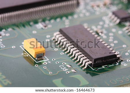close up of a electronic hardware, silicon chips on a green board - stock photo