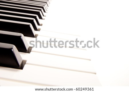 Close-up of a electronic piano keyboard on white - stock photo